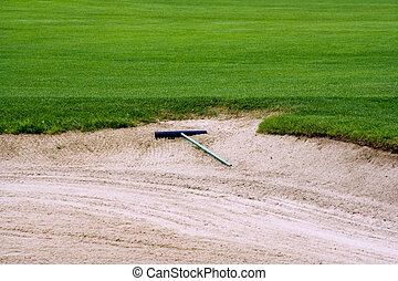 sand trap - Sand trap on a golf course on the edge of the...