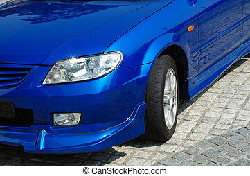 Front view of sportive car - A close up shot (front view) of...