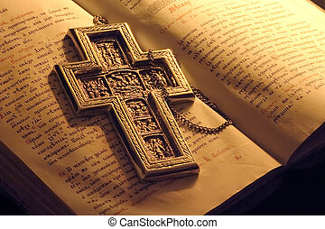 Old manuscript and silver cross of mine