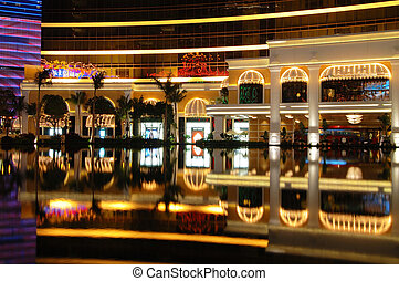 Entrance of hotel with reflection over fountain