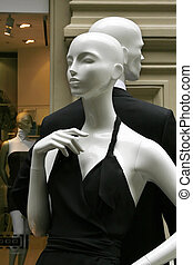 Pair dummies in a show-window of shop of fashionable clothes
