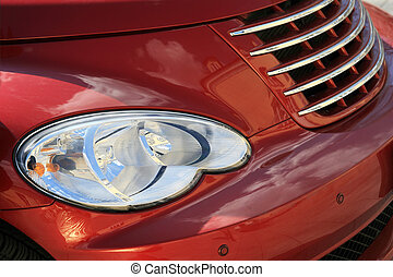 headlights - The right headlight and bumper of the red...