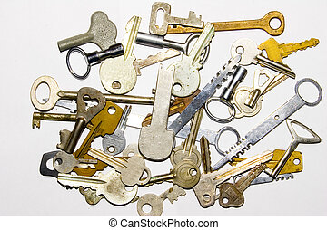 old keys - the many old keys on white background