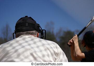 Baseball Umpire - Baseball umpire crouched behind batter...