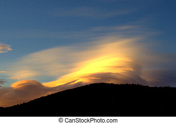 Sunrise in the Mountains - Sunrise shot of clouds rolling...