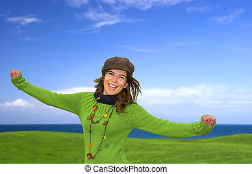 Happy woman in a great beautiful landscape