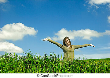 Happy woman - Happy young with open arm in the field