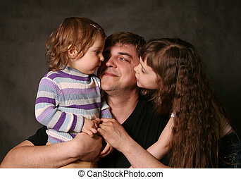 Daddy and two daughters - Portrait of daddy and his two...