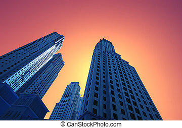 High blue skyscrapers at gold orange sunset