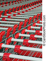 shopping troleys - parked shopping trolleys, red and grey...