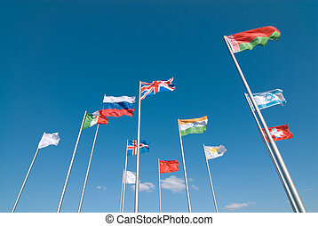 Flags waving across deep blue sky - International flags...