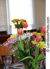 Easter Flowers - Two bouqets of Easter flowers on dining...