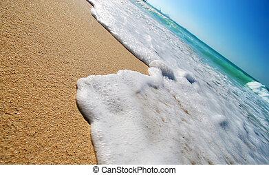 Tropical beach - Sea waves on tropical beach in natural...