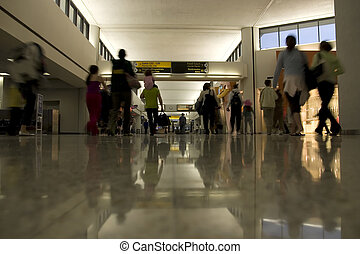 Departure area of airport - people traveling