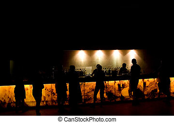 Night bar - People in the bar at night - light and darkness.