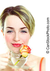 Girl with rose in the cup