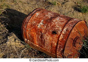 Barrel With Bullet Hole - Old barrel in weeds with bullet...