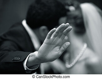 Hands of the groom - The groom is closed from the...