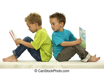 Whats he Reading - Two friends reading a book, one boy...