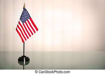 American office - American flag on a glass table, office...