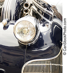 Headlamp of a classic car - Close-up of the head lamp of a...