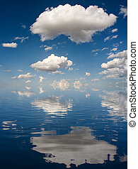 Big White Clouds - Big white Clouds reflected on water.