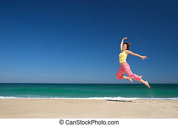 Woman Jumping - beautiful woman jumping in the beach