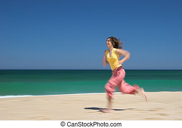 Running fast - Woman running on the beach