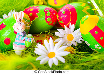 Easter bunny and colorful painted eggs