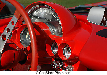 red dashboard from 1960\\\'s classic sports car