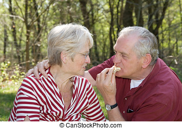 Teasing - Elderly couple at a picnic in the forest