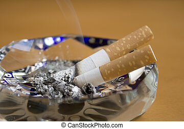 Cigarette and ashtray on the table