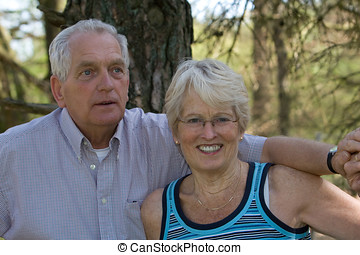 Senior couple - Lovely senior couple outdoors together on a...