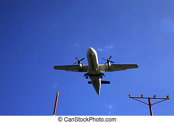 Plane Landing - Airliner on final approach with runway...