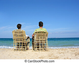 behind sitting couple on
