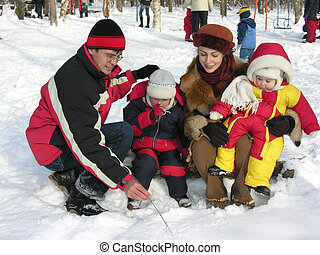 family of four in winter
