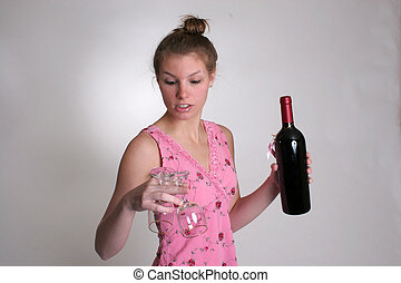 cute woman with wine - A cute woman with a bottle of wine...