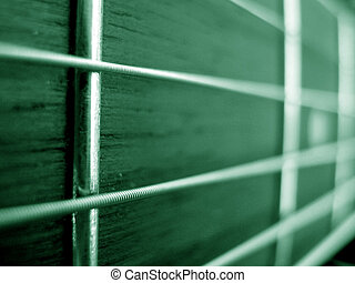 Green Strings - A beautiful background of guitar strings