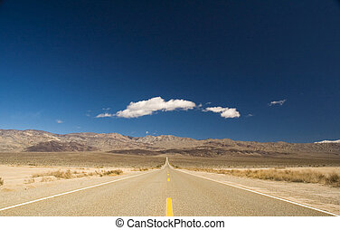 Straight road in Death valley heading into the mountains...