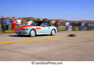 Racing car - Panning image of a peedy car during a legal...