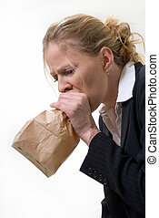 Panic attack - Blond woman holding a brown paper bag over...