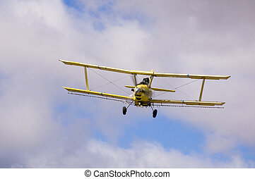 Crop duster spraying fields - Aircraft-Crop duster spraying...