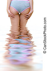 Beautiful naked woman standing in the water - Woman standing...