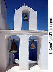 Bell tower with three bells on the greek island of Santorini