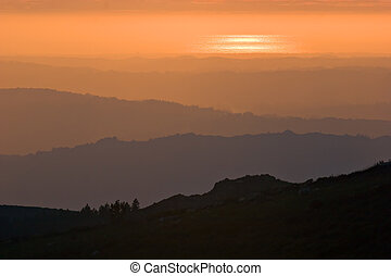 Layers - View over layered mountains on a beautiful Sunset.