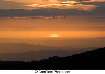 Layers - View over layered mountains on a beautiful Sunset