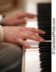 Piano - The image of the piano and man\\\'s hands