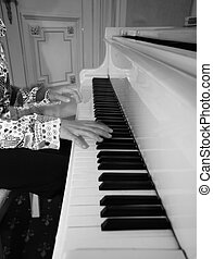 Grand piano - The image of the piano and childs hands bw...