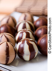 Rows of chocolate candies - Rows of chocolate striped...