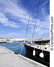 Sheltered - Yacht or sailing boat moored at quayside on the...